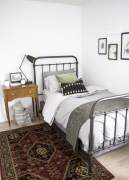 Iron bed in bedroom