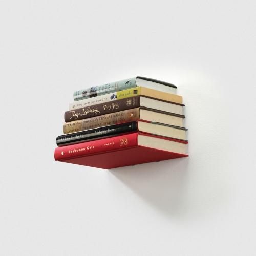 knygos prie sienos