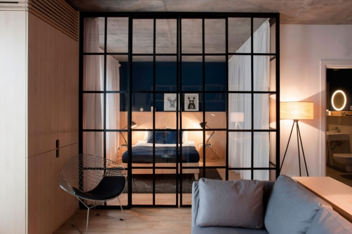 bedroom with glass partition