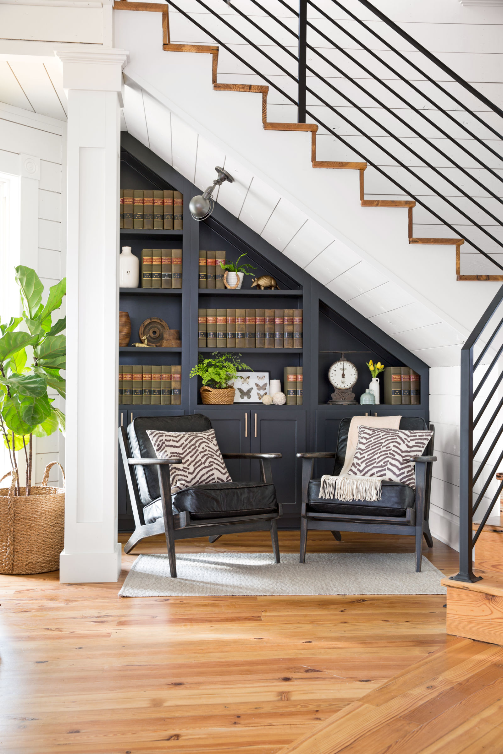 Countryliving.com · Library Under Stairs